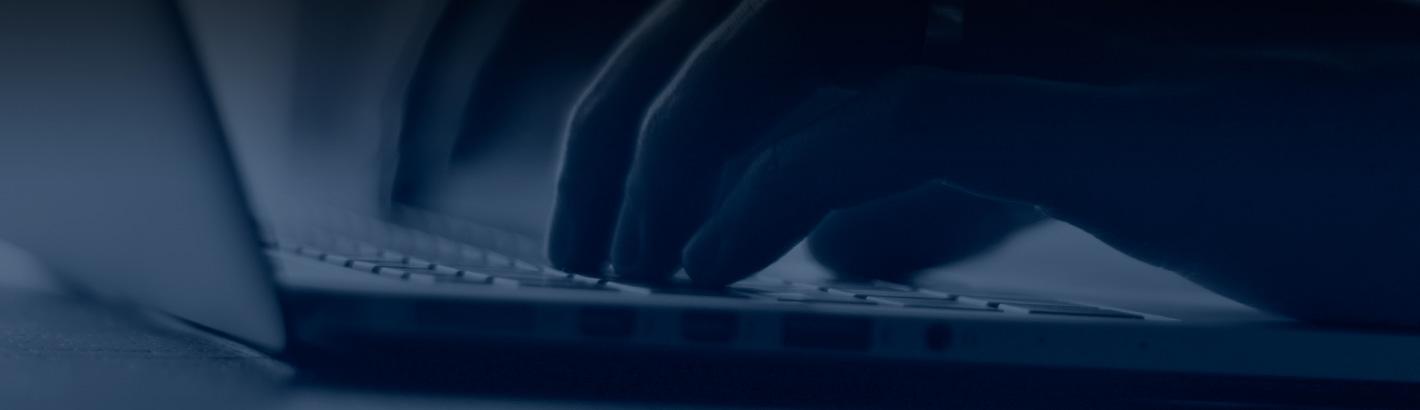 Closeup Of Hands Typing On Laptop Keyboard Asian Atlantic Industries Aai Inc