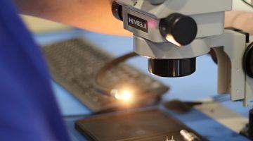 Microscope with fiber optic lighting